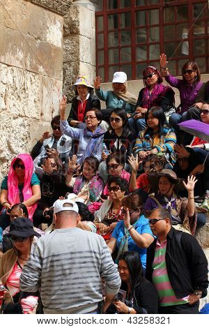 Pilgrims  From South-east Asia  Near Church Of The Holy Sepulcher