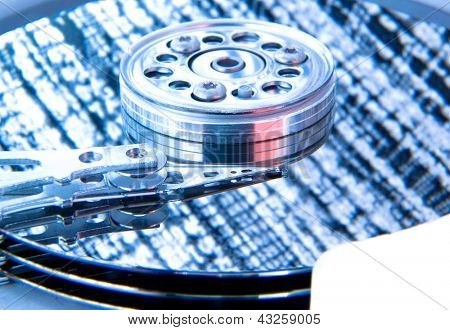 close up of hard disk with blue abstract technology reflection