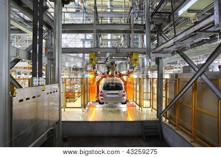 TOGLIATTI - SEPTEMBER 30: Passenger car hangs on assembly line at Avtovaz factory on September 30, 2011 in Togliatti, Russia. In 2013, Russia largest carmaker Avtovaz celebrating 47th birthday.