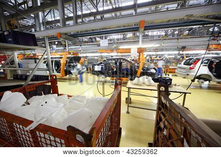 TOGLIATTI - SEPTEMBER 30: Car assembly, workers at Avtovaz factory on September 30, 2011 in Togliatti, Russia. Russian President Vladimir Putin signed decree awarding state awards to AvtoVAZ.