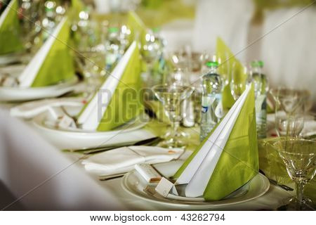 Festive table setting for wedding, Valentine or other event ( Empty place cards on the white festive table )