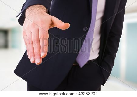 Business man giving hand.