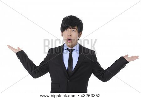 Young businessman with surprise expression on his face isolated