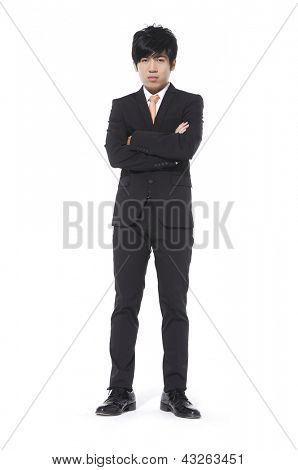 Full body young business man standing with crossed arms over white background
