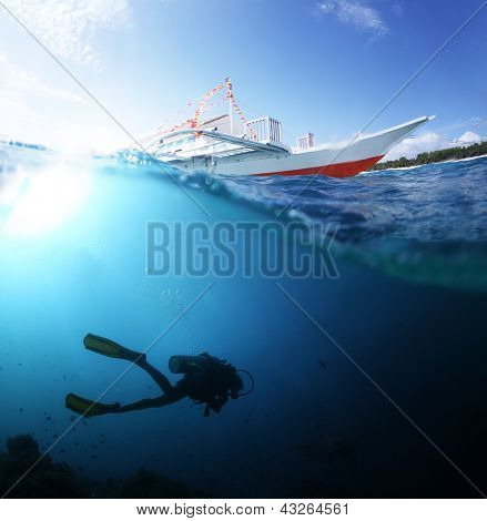 Collage with scuba diver underwater and traditional boat on a surface at sunny day