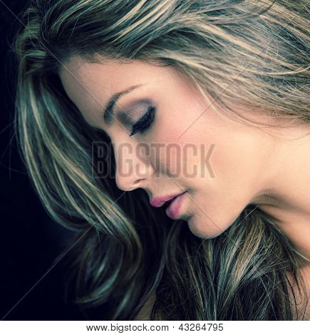 Gorgeous woman portrait - isolated over a black background