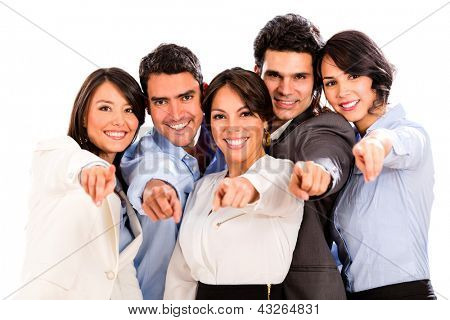 Happy business group pointing at the camera - isolated over white