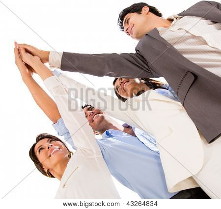 Group of business people celebrating their teamwork with a high five