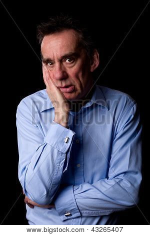 Sad Anxious Depressed Business Man With Hand To Chin