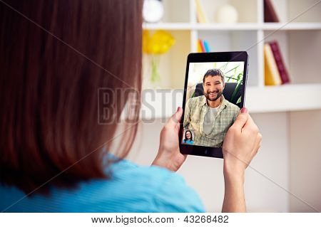 young couple talking online video chat