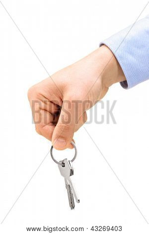 A male hand holding keys on a key ring, isolated on white background