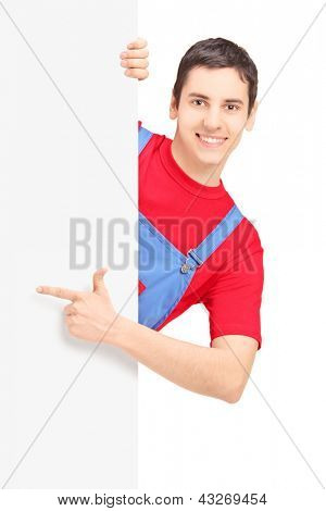 Repairman pointing on a blank panel isolated against white background