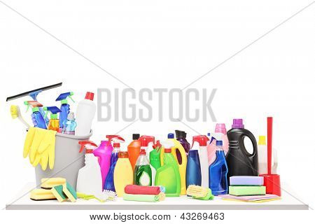 Studio shot of a cleaning supplies on a table isolated on white background