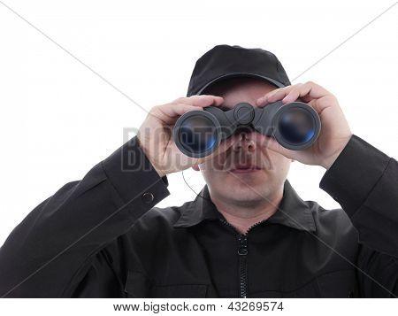 Security man wearing black uniform looking through binocular, shot on white