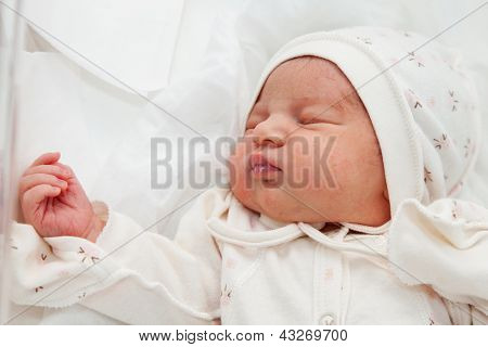 Newborn Girl In The Maternity Hospital