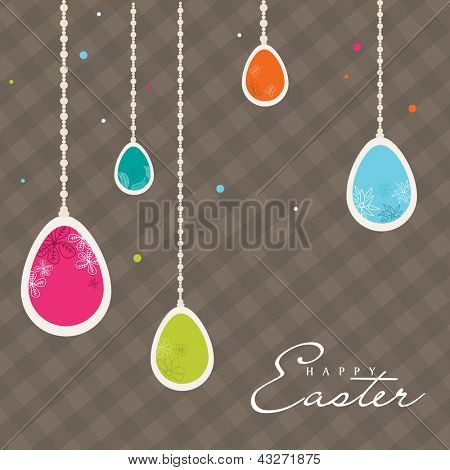 Vintage Easter card with hanging colorful eggs.