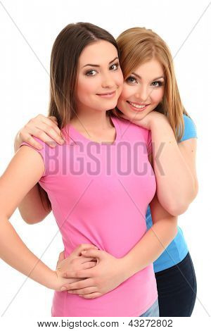 Two girl friends smiling isolated on white