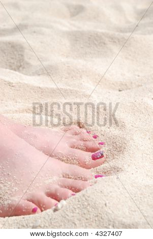 Pedicured Feet In White Sandy Beach