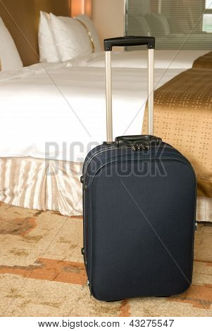 Suitcase Stands Up Inside A Hotel Room