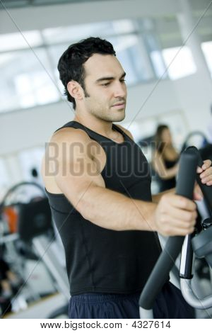 Man Exercising At The Gym