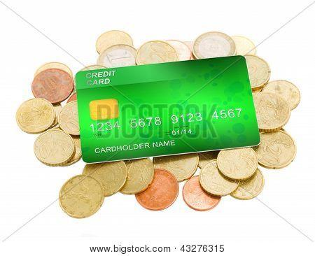 pila de monedas y tarjetas de plástico