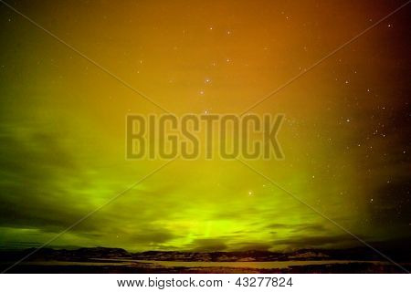 Surreal Northern Lights with clouds and stars sky