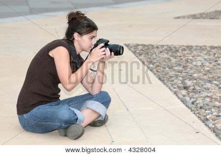 Woman Photographer Sitting