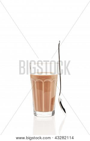 chocolate milk with a standing spoon