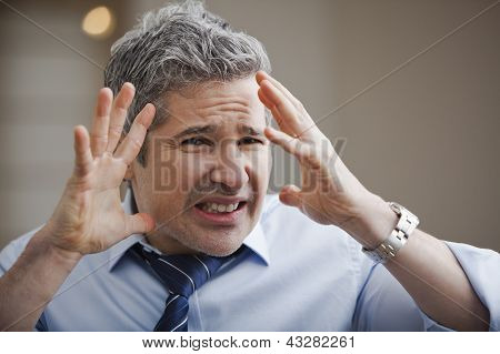 Close-up Of A Businessman Looking Frustrated