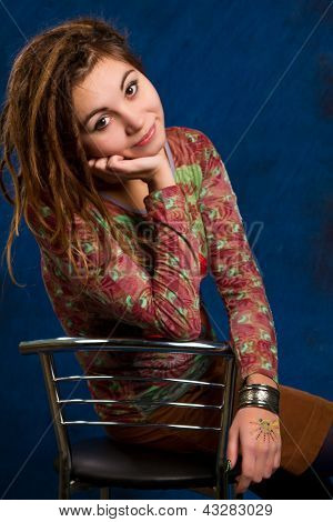 Portrait  Woman With Dreadlocks Against  A Blue Background