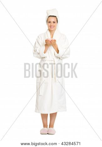 Full Length Portrait Of Young Woman In Bathrobe Holding Cup Of C