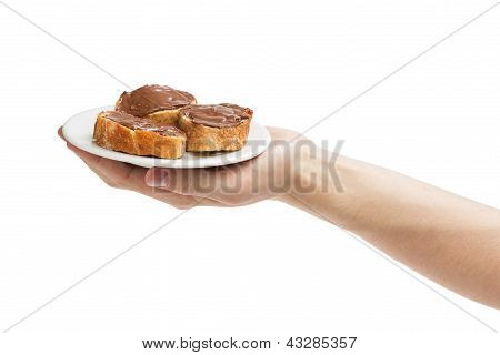 Baguette Slices Spread With Nut-choco Paste In Man Hand