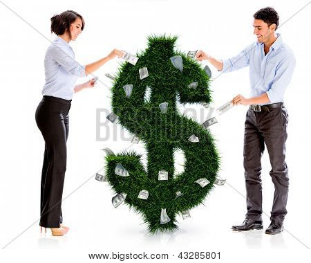 Business people with a money plant - isolated over white
