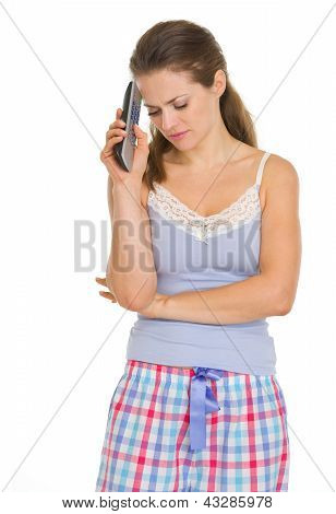 Frustrated Young Woman In Pajamas With Tv Remote Control