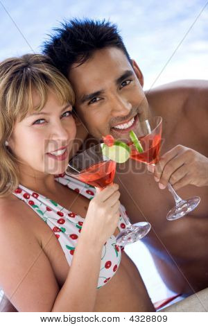 Happy Couple Relaxing By The Pool