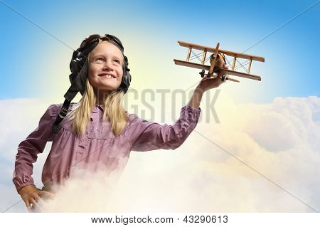 Little girl in pilot's hat