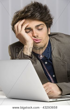 Sleeping Overworked Businessman At Work