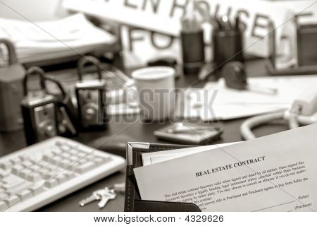 Real Estate Contract On Realtor Desk