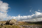 pic of errat  - Norber Erratics with Moughton Scar and Wharfe Dale in background in Yorkshire Dales National Park - JPG