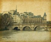 Seine.Pont Neuf in central Paris, France. Photo in retro style. Paper texture.