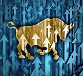 stock photo of bull  - Bull market business concept with a group of organized arrows going up as investor confidence in stock trading predicting future price increasesas a financial symbol of profits - JPG