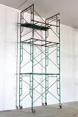 image of scaffolding  - freen color iron scaffold with wheel in warehouse - JPG