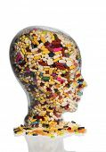 stock photo of placebo  - a head made of glass filled with many tablets - JPG