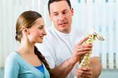 stock photo of spinal-column  - Physiotherapist in his practice - JPG