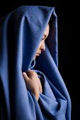 stock photo of yashmak  - Portrait of pensive religious woman on a black background - JPG