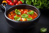 Homemade delicious minestrone soup with basil