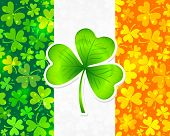 stock photo of triskele  - Vector Irish flag background made from green and orange clovers with big clover on it - JPG