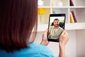 stock photo of video chat  - young couple talking online video chat - JPG