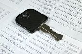 pic of paycheck  - A black key with account passbook background - JPG