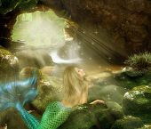 stock photo of cave woman  - Photomanipulation girl mermaid in a cave filled with light and water - JPG
